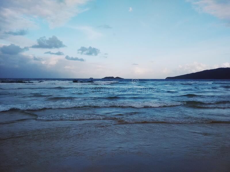 Dramatic beach scene. Processed with VSCO with au5 preset stock photography