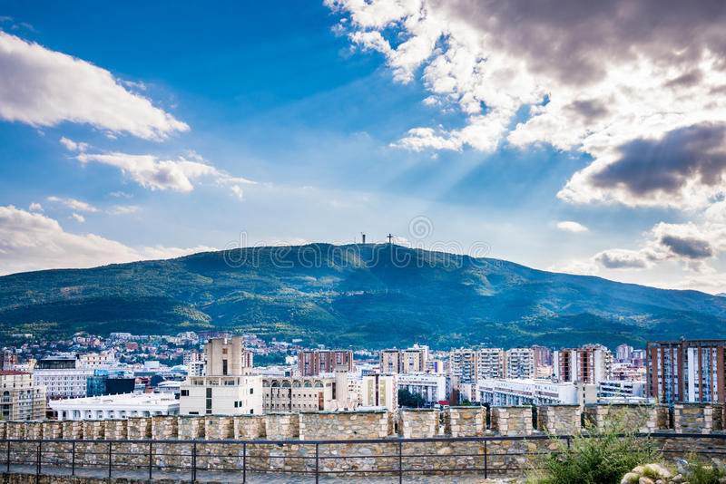 Dramatic and beautiful city landscape view of the city Skopje in Macedonia with the mountain Vodno. stock photography