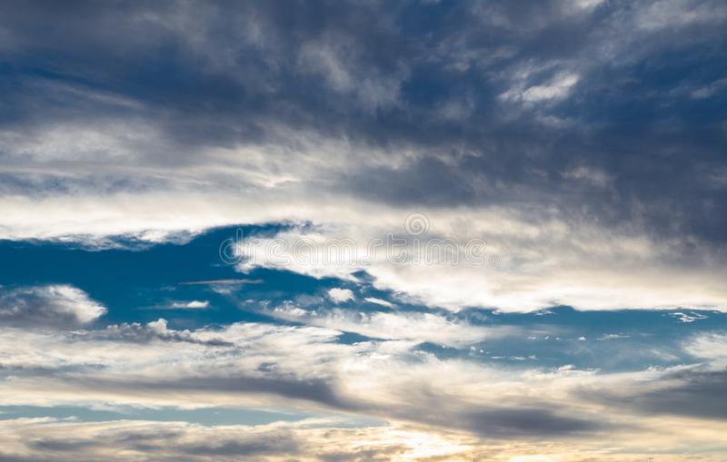 Dramatic Beautiful grey clouds pattern in sunset light sky. royalty free stock photos
