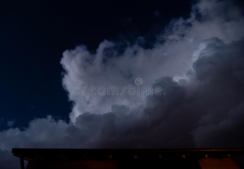 Dramatic big clouds at the night sky with stars stock images