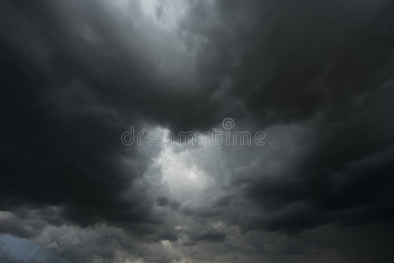 Dramatic black clouds or dark storm cloud. Before rainy stock image