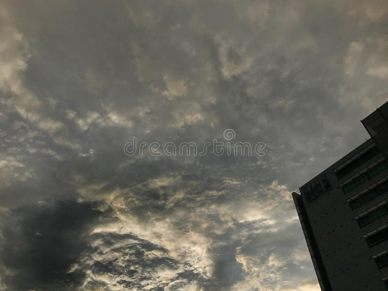 Black sky before storm and raining at Thailand. Dramatic black sky before storm and raining at Thailand royalty free stock photos