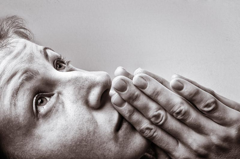 Woman during a prayer stock photo