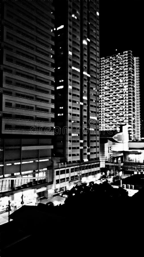 A dramatic black and white night view of Cityland and Zitan Condominiums in Mandaluyong, Philippines. A dramatic black and white mode view of cityland and zitan stock photography