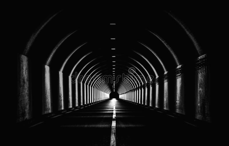 Dramatic Black White Monochrome Highway Tunnel Night Time Light Shapes Dark Abstract. Dramatic Black White Monochrome Highway Tunnel Night Time Light Shapes Dark royalty free stock photos