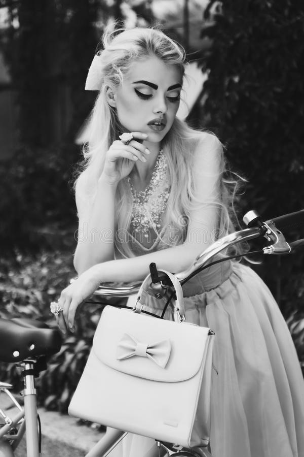 Dramatic black and white vintage portrait of a glamorous blonde girl royalty free stock images