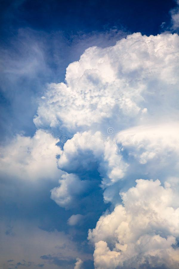 Dramatic blue sky with white stormy clouds before the rain. royalty free stock photo
