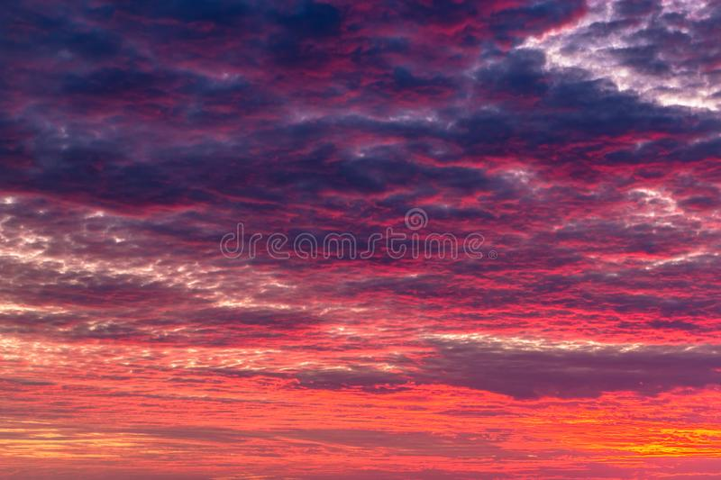 Dramatic Burning Sky at Sunrise. Image of colorful mammatus clouds at dramatic red sunrise for abstract background stock photos
