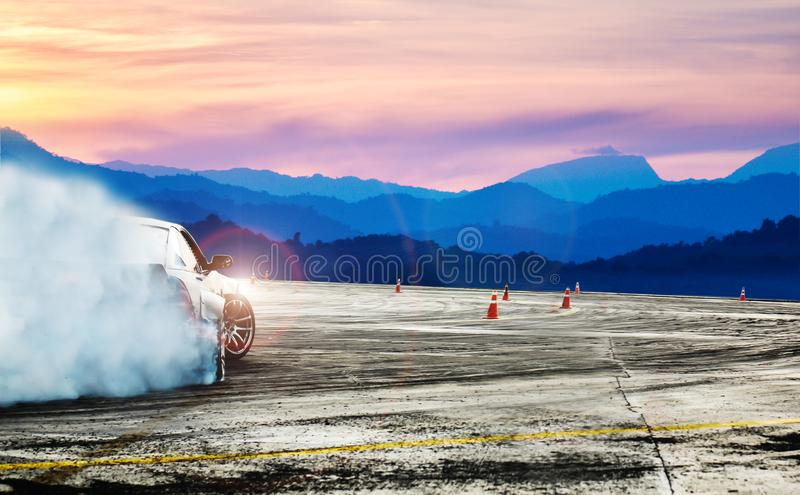 Dramatic car drifting, Blurred of image diffusion race drift car. With lots of smoke from burning tires on speed track stock image
