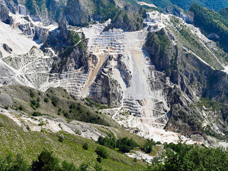 Dramatic Carrara marble quarry, mountain view. Italy. Stunning. Vast scale of industrial operation, with hairpin,zigzag roads. Campo Cecina royalty free stock image