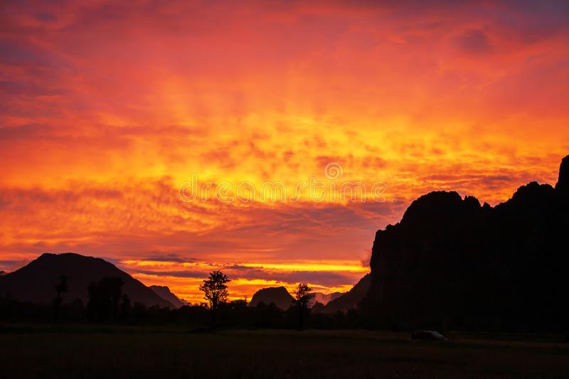 Dramatic clouds above a limestone mountain range, colorful ripple clouds on sunset sky, fantastic winter scene in North Laos stock images