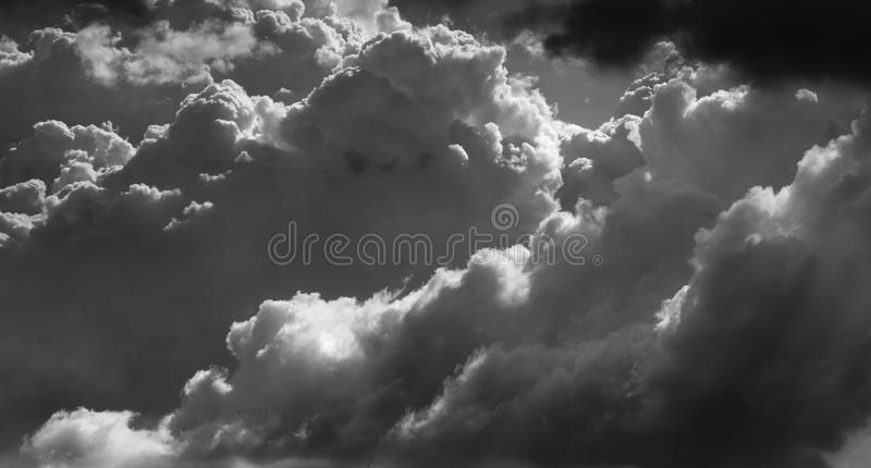 Dramatic clouds in black and white stock image