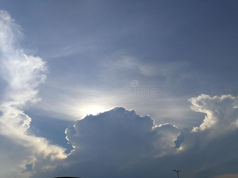 Dramatic clouds in the bright sky royalty free stock photo