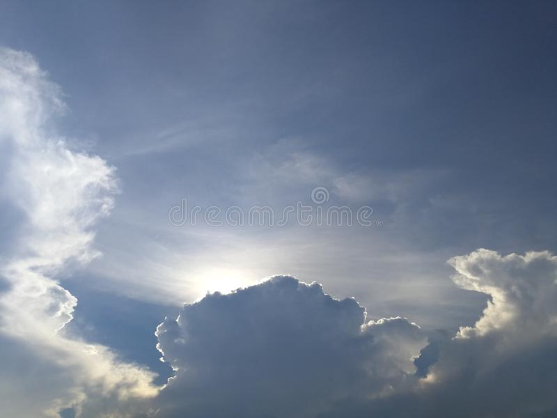 Dramatic clouds in the bright sky royalty free stock images