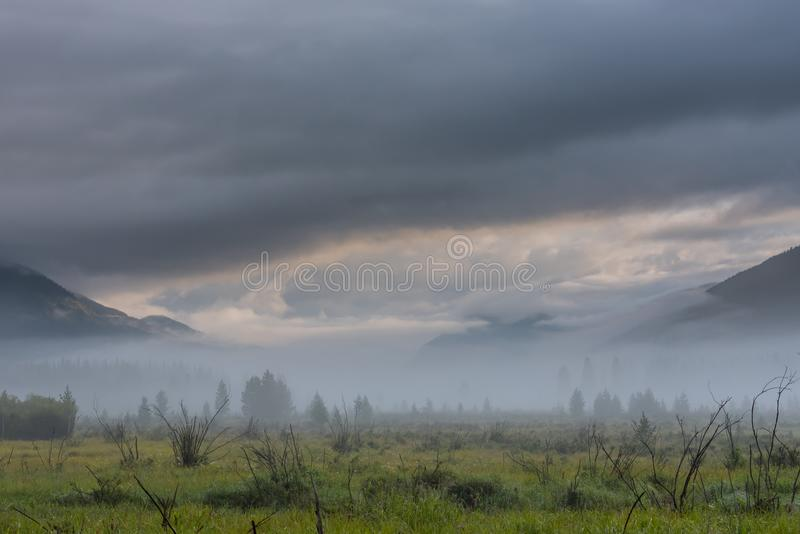 Dramatic Clouds Above Rocky Mountain National Park Valley. Dramatic Clouds and Fog Above Rocky Mountain National Park Valley royalty free stock image
