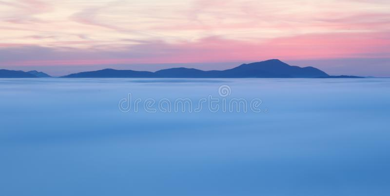 Dramatic clouds with mountain silhouette in dawn, Slovakia. royalty free stock image