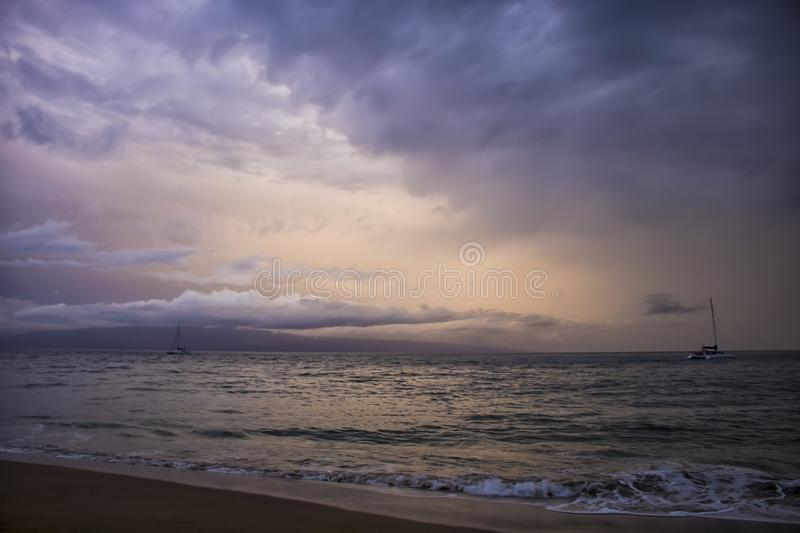 Dramatic Clouds over Ocean Sunset with Boats as Hurricane Storm royalty free stock photos