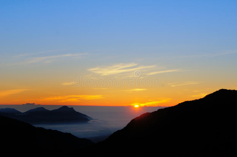 Dramatic Clouds rolling over mountains at sunrise-Hehuan shan/ Joy mountain. In Taiwan royalty free stock photos