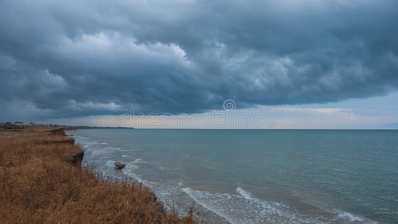 Dramatic clouds in the Azov Sea before the storm. Dramatic clouds on the shore of the Sea of Azov before the storm royalty free stock image