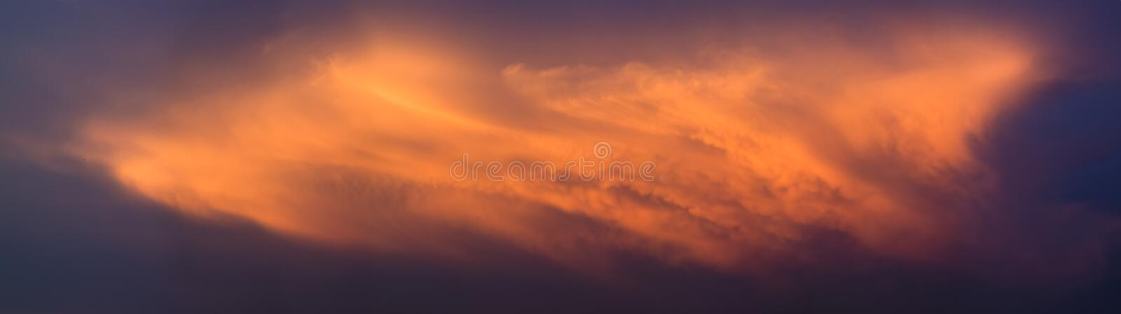 Dramatic clouds with sunset light, Panoramic view. Of clouds royalty free stock photos