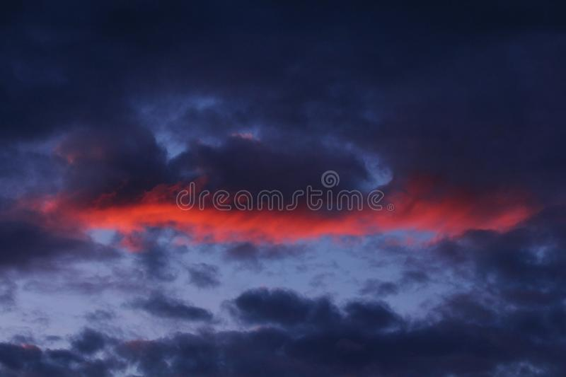 Dramatic clouds on sunset sky. Summer sunset with dramatic clouds royalty free stock photography