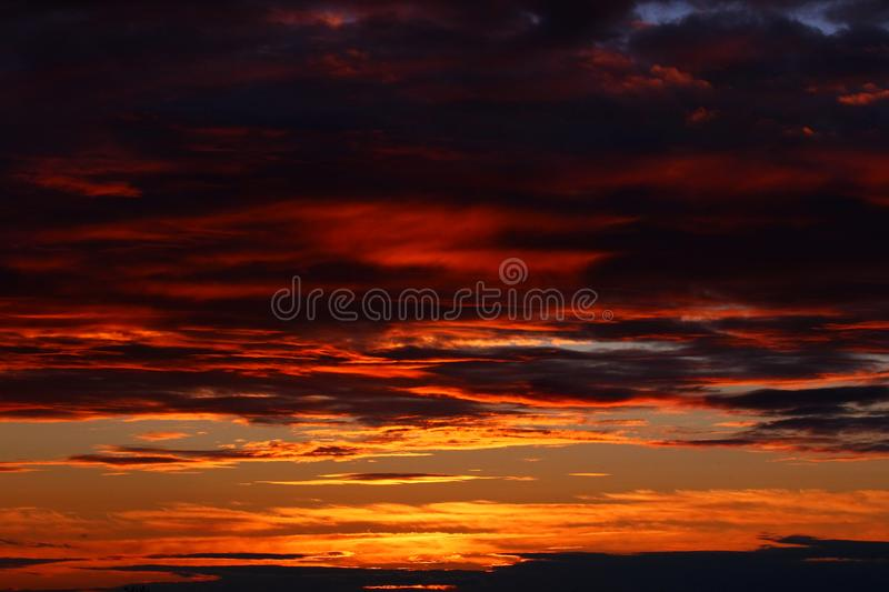 Dramatic clouds on sunset sky. Summer sunset with dramatic clouds stock photography
