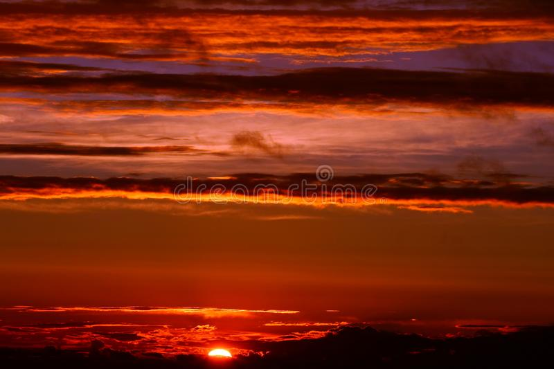 Dramatic clouds on sunset sky. Summer sunset with dramatic clouds royalty free stock photo
