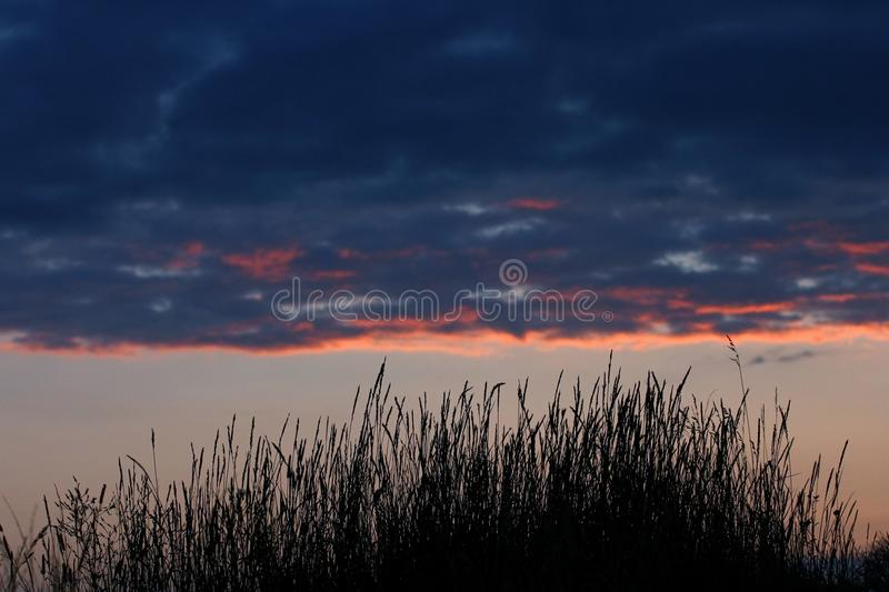 Dramatic clouds on sunset sky. Summer sunset with dramatic clouds stock images