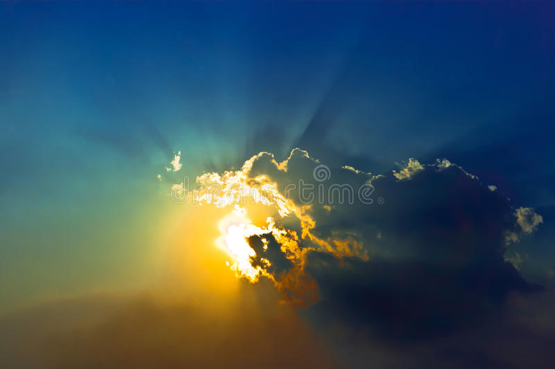 Dramatic cloudscape in blue sky. Dramatic cloudscape with sumbeam in blue sky royalty free stock images
