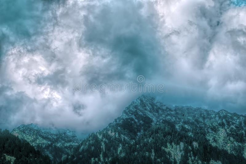 Dramatic cloudscape over himalayan mountains in Kashmir. Beautiful dramatic cloudscape over himalayan mountains in Kashmir, India stock images