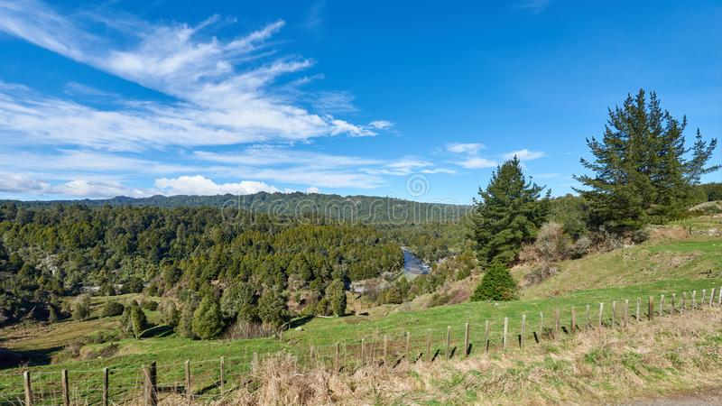 Dramatic cloudscape in rural New Zealand. Dramatic cloudscape over a lush green fenced paddock in rural New Zealand royalty free stock images