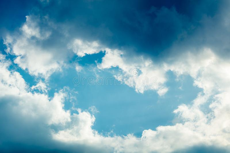 Clouds frame in sky. Dramatic cloudscape and sunlight jet view background stock photography