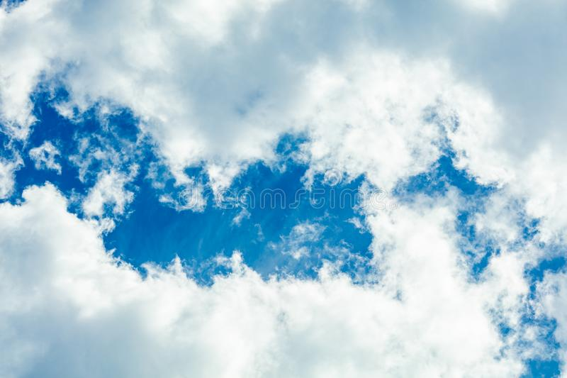 Clouds frame in sky. Dramatic cloudscape and sunlight jet view background royalty free stock image
