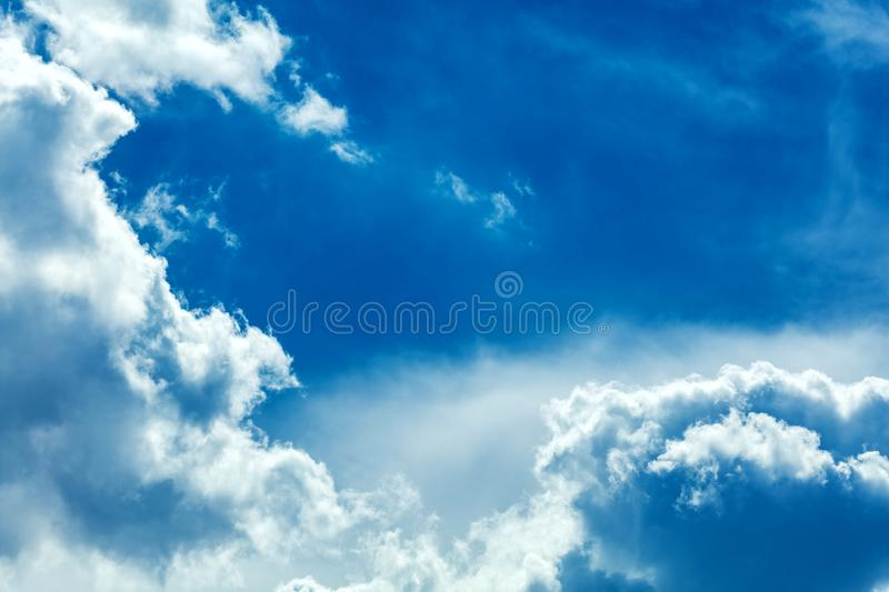 Clouds frame in sky. Dramatic cloudscape and sunlight jet view background stock images