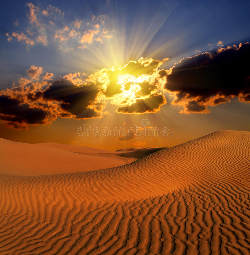 Dramatic suset landscape in desert stock photography