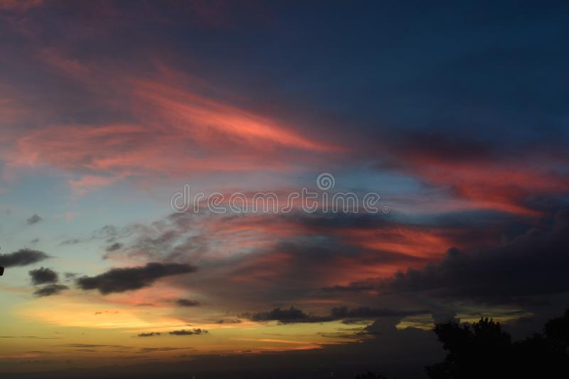 Colorful dramatic sky with sunset and claud. Dramatic color of the sky with sunset and black orange yellow clouds over the Indonesian sky in the dry season after royalty free stock photo