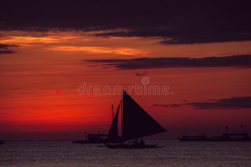Dramatic colorful sea sunset with sailboat. Summer time. Travel to Philippines. Luxury tropical vacation. Boracay paradise island stock image