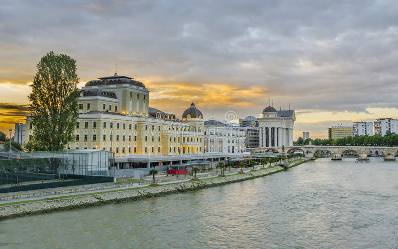 Dramatic colorful sunrise view of downtown of Skopje, Macedonia. Beautiful sunrise view of museum, stone bridge and Vardar river in Skopje, Macedonia royalty free stock photography