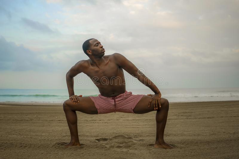 Dramatic contemporary dance choreographer doing ballet beach workout, young attractive and athletic afro black American man. Dramatic contemporary dance stock image