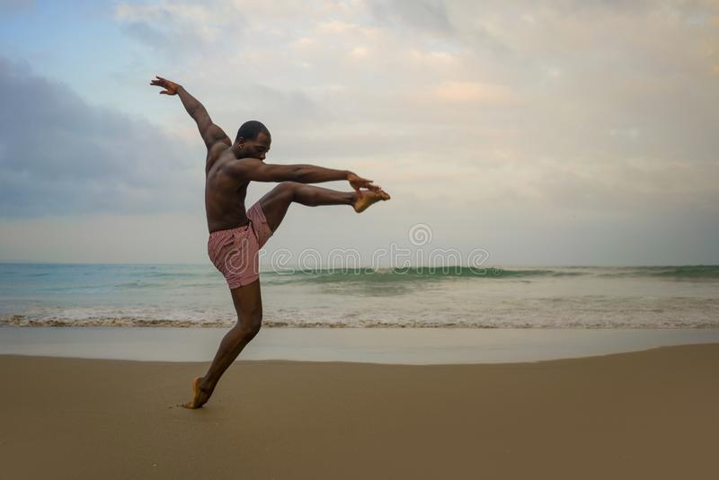 Dramatic contemporary dance choreographer doing ballet beach workout, young attractive and athletic afro black American man. Dramatic contemporary dance royalty free stock photography