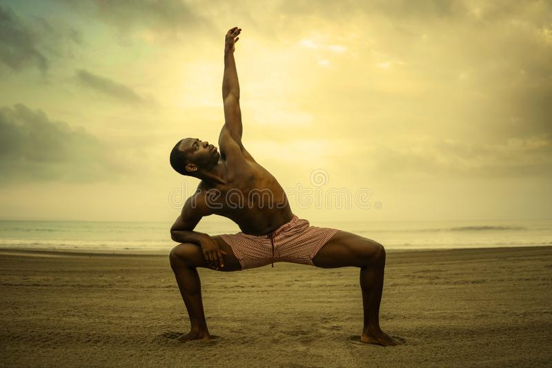 Dramatic contemporary dance choreographer doing ballet beach workout, young attractive and athletic afro black American man. Dramatic contemporary dance royalty free stock photo