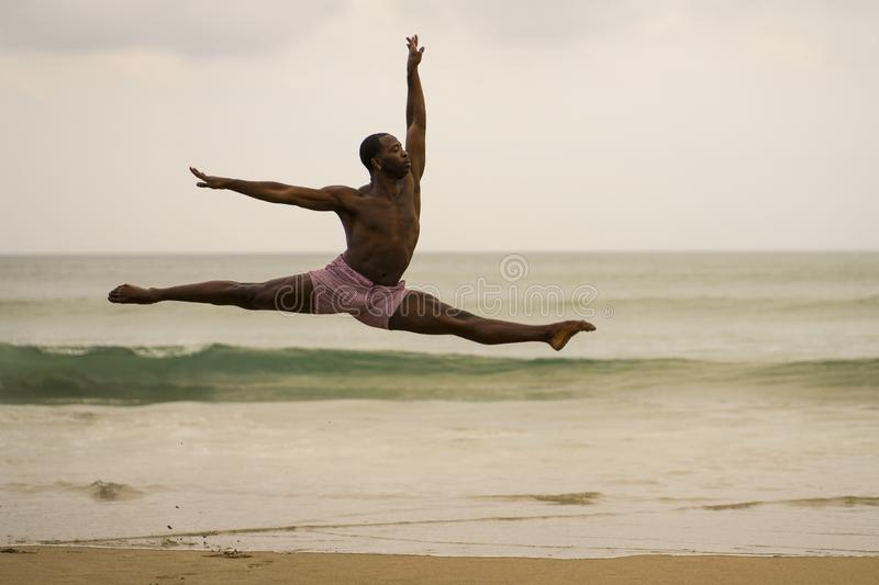 Contemporary dance choreographer doing ballet beach workout . young attractive and athletic black African American man dancing on. Dramatic contemporary dance stock image