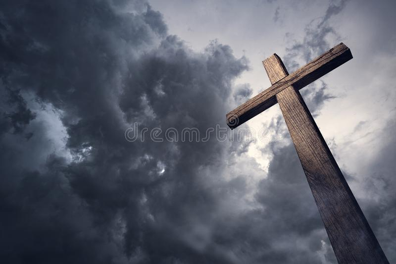 Dramatic cloudscape and wooden cross. Dramatic dark cloudscape and wooden cross. Christian Concept. Religious Concept royalty free stock photos