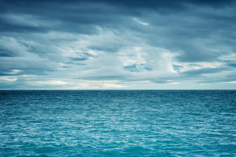 Dramatic dark cloudy sky over the sea royalty free stock photo
