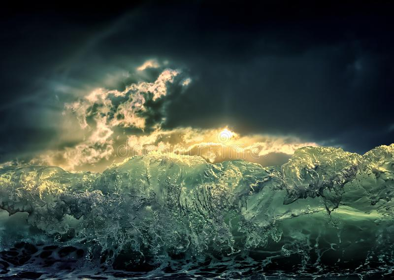 Dramatic dark ocean sea storm view with sun light clouds and waves. Abstract nature background. Climate concept. Extreme weather royalty free stock photography
