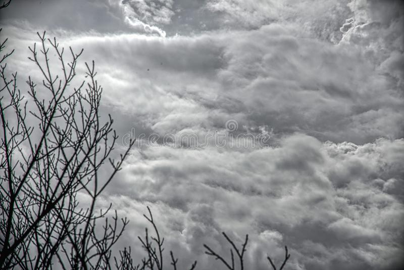 Dramatic dark sky and clouds. Cloudy sky background. Black sky before thunder storm and rain. Background for death, sad, grieving. Dramatic dark sky and clouds royalty free stock photo