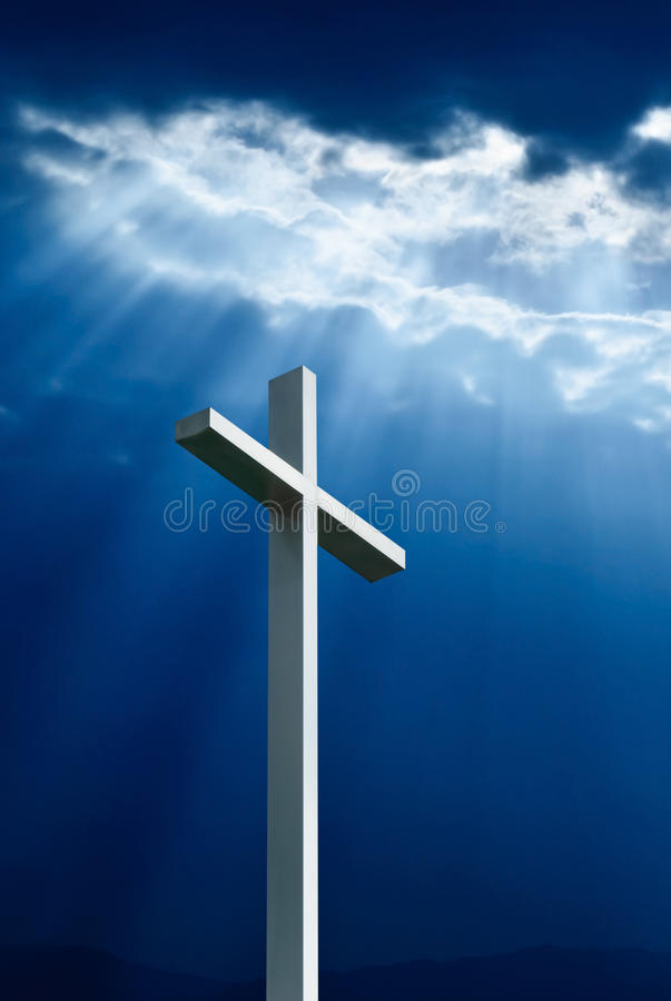 Dramatic deep blue Jesus light shining down on cross. With copy space royalty free stock images