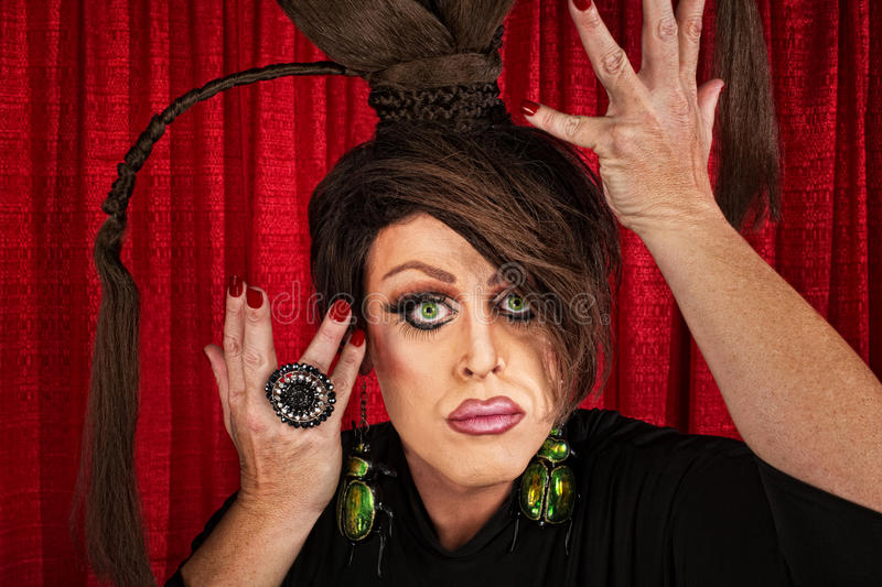 Dramatic Drag Queen. Big drag queen in theater fixing his hair royalty free stock photography