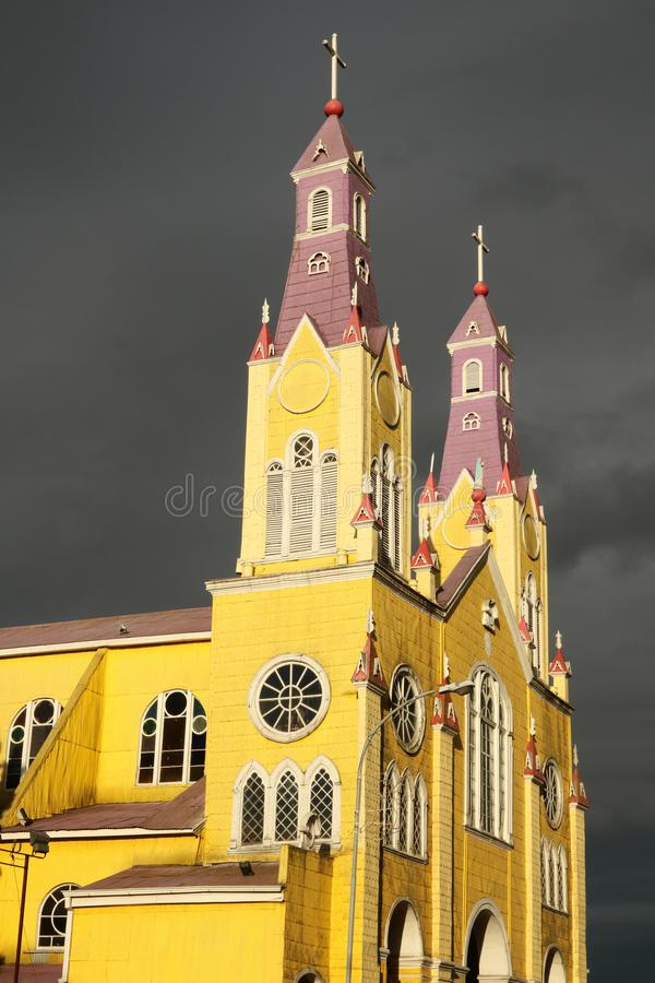 Wooden church in Castro, Chile. Dramatic evening light on the historic cathedral in Castro on Chiloe Island in Chile - a UNESCO heritage site stock photography
