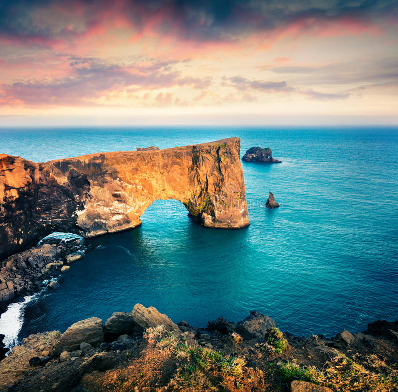 Dramatic evening scene of Dyrholaey arch. stock photography